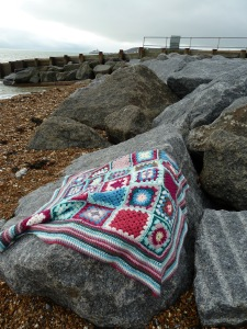 Sarah and Ben's blanket as utilized for a romantic picnic on a beach, on a really cold day.