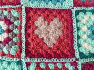 heart granny square, in various shades of pink