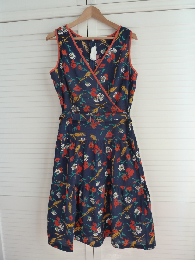 navy sun dress dotted with poppies, corn and daisies